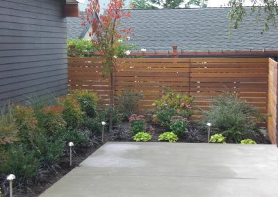 horizontal-fencing-with-planting-and-lighting-min